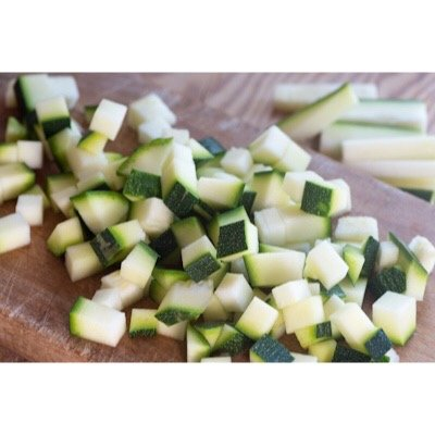 Zucchini carefully diced and prepped for dehydrated meals.